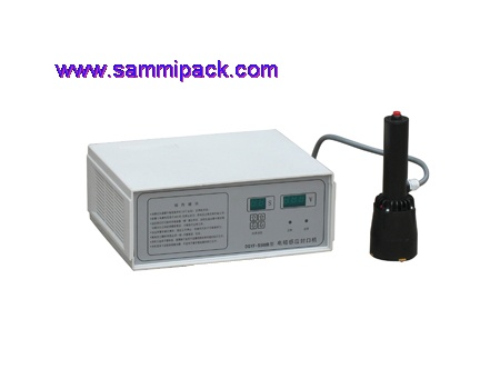 Hand held induction sealing machine